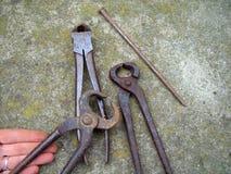 Старые инструменты утюга стоковая фотография