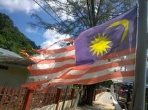 Старое полное флага отверстий малайзийского развевая на ветре стоковое изображение