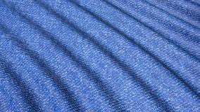 Створки джинсовой ткани движения голубые материальные акции видеоматериалы