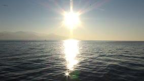 Сцена захода солнца в море сток-видео