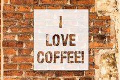 Схематическое сочинительство руки показывая я люблю кофе Привязанность текста фото дела любя для горячих напитков с кофеином стоковые фото