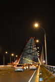 Ð¡able-stayed through arch bridge over river Ob in Novosibirsk at night, Siberia stock images