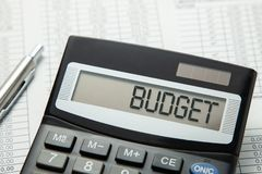 Calculator with the inscription on the BUDGET display on the paper tables. Family budget royalty free stock photos