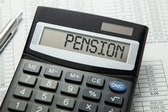 Calculator with the inscription on the PENSION display on the paper tables. Pension calculation.  royalty free stock photos