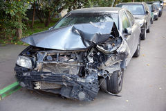 Сar with a broken nose section is among other cars Royalty Free Stock Images