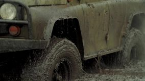 Ð¡ar goes through the mud. Car goes through the mud. Slow motion stock footage