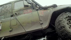 Ð¡ar goes through the mud. Car goes through the mud. Slow motion stock video