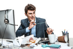 Ð¡atapult slingshot. Modern office man at working place, sloth and laziness concept royalty free stock photography