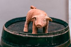 Ð¡eramic toy pig on a wine barrel. Chinese horoscope year of the. Pig. 2019 new year of pig. Chinese New Year. Symbol of the new year 2019 stock photography