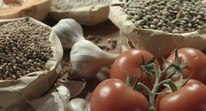 Ð¡ereals, tomatoes, pumpkin, lentil. Ðœegetables, cereals, condiments on the kitchen table stock footage