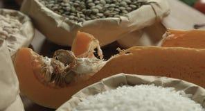 Ð¡ereals, tomatoes, pumpkin, lentil. Ðœegetables, cereals, condiments on the kitchen table stock video footage
