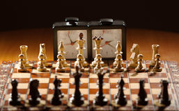 Ð¡hessboard, clock and figures royalty free stock image