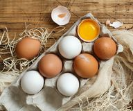 Сhicken eggs in a box. On a wooden background Royalty Free Stock Image