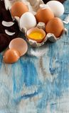Сhicken eggs in a box. On  a blue wooden background Royalty Free Stock Images