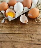 Сhicken eggs in a box. On a wooden background Royalty Free Stock Photography