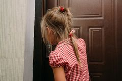 Ð¡hild opens door himself. Safety of children. Ð¡hild of the house is alone. royalty free stock photos