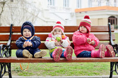 сhildren on the bench royalty free stock photos