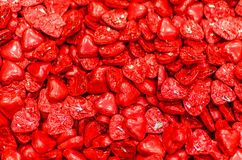 Ð¡hocolate candy red wrapper heart shaped Royalty Free Stock Image