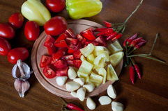 Ð¡hopped tomatoes and pepper Royalty Free Stock Images