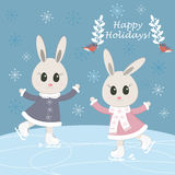 Сhristmas postcard with funny bunnies skating Royalty Free Stock Photography