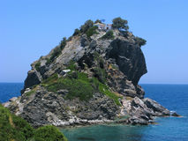 The church high on cliff. Mamma Mia film. Greece. The church of Agios Ioannis at Skopelos island on cliff top in sea. Here was filmed famous movie 'Mamma Mia stock image