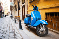 Сity ​​street and scooter Royalty Free Stock Photos