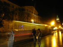 Сity tram in the evening city. Tram - Ghost stock images