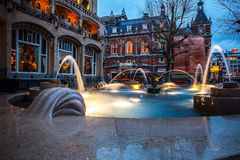 Ð¡ity fountain with illumination in twilight time. Photo stock images