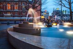Ð¡ity fountain with illumination in twilight time. Photo stock photos