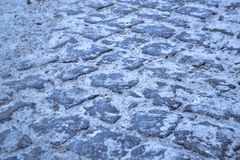 Сobbles background. Cobbles texture with sand. Cobbles road with sand Stock Photography
