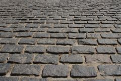 Сobblestone pavement. Сobblestone pavement pattern texture background image Stock Images