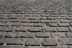 Ð¡obblestone pavement. Сobblestone pavement pattern texture background image stock images