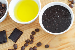Ð¡ocoa dark chocolate, olive oil and ground coffee mask scrub. Diy cosmetics. stock images