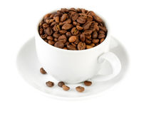 Сoffeeсup pervaded grain coffee. Isolated on white backgound Royalty Free Stock Image