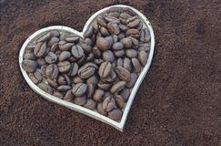Сoffee beans in a heart shaped box. royalty free stock photography