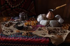 Сoffee table with the cezva on sand and patterned tablecloth in Stock Images