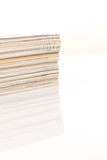 Ð¡olorful magazines up close shot on white background. With reflection royalty free stock image