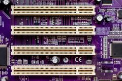 сomputer chip in purple with yellow color slots_ stock photos