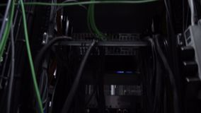 Ð¡omputers, data center. Bottom view, moving camera. Ethernet Network Connection Hub. Blinking lights in a dark server room.  stock footage