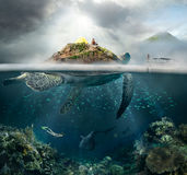 Ð¡oncept of travel in the mountains, and under water. Beautiful underwater view island-turtle and traveler above and below the water surface in turquoise royalty free stock image
