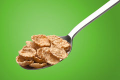 Ð¡orn flakes in a metal spoon royalty free stock photo