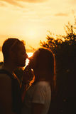 Сouple kissing on the sunset at the Garda Lake, Italy. stock image