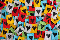 Сrumpled сolorful pieces of paper with hearts stock image