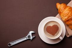 Cup of coffee with heart on the foam. I like to coffee break with croissant. Repair service concept. Technical support stock images