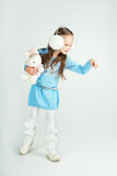 Сute girl in winter clothes pointing to something Royalty Free Stock Photography