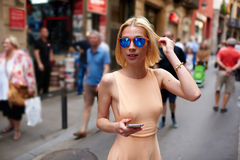 Ð¡ute hipster girl with body strolling outdoors royalty free stock image