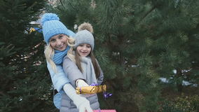 Ð¡ute mother and daughter with presents at the fir-tree background stock video footage