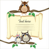 Ð¡ute owls on a branch on the old scroll background with space for text royalty free illustration