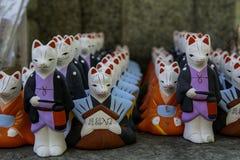 Удачливые коты для японца молят везение в виске стоковое изображение rf