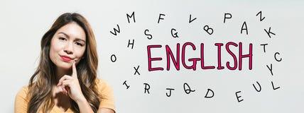 Учить английскую тему с молодой женщиной стоковые фото
